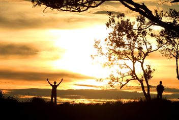 Silhouettes of men at sunset - Free image #338489
