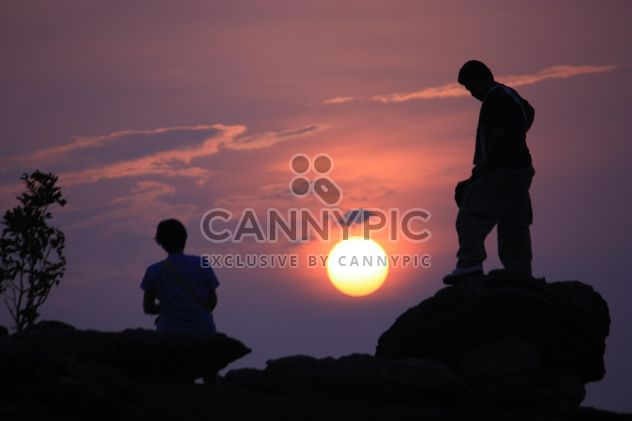 Silhouettes of people at sunset - Free image #338499