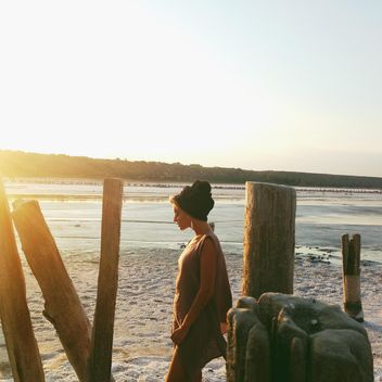 Girl on seashore at sunset - Free image #338519