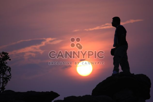 Silhouette of man at sunset - Free image #338529