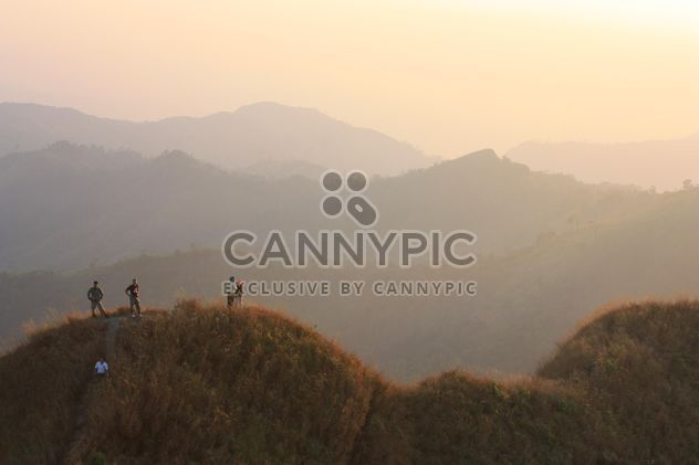 People on rock at sunset - Free image #338569