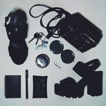 Still life with bag, purse, notebook, pen, keys, mirror, earrings, bangle, ring, shoes, chunky heels, black and white - Free image #342479