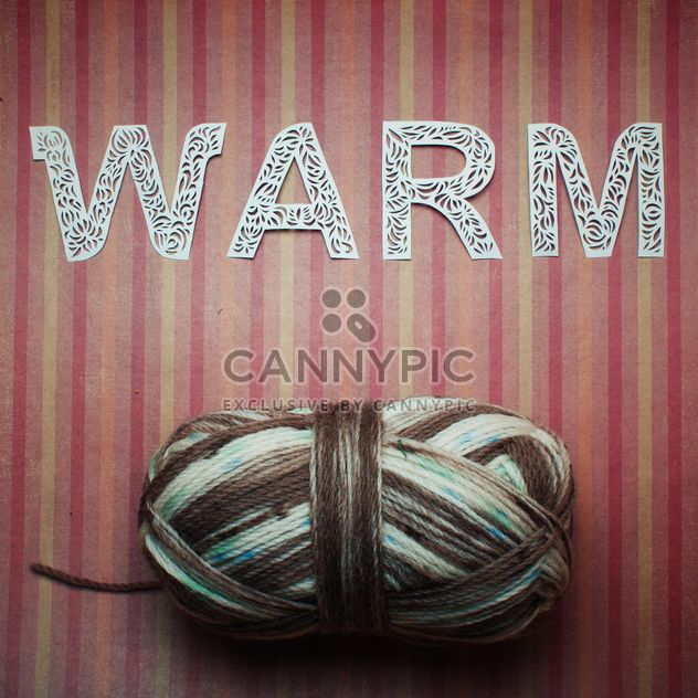 Laced letters and yarn on striped background - Free image #342539