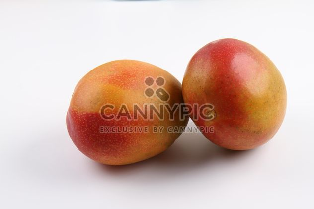 Two ripe Mangoes isolated on white - Free image #342909