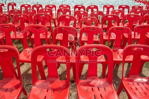 Red and white plastic chairs - Free image #344529
