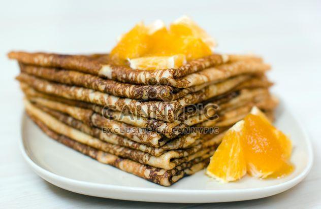 Closeup of pancakes with orange on plate - Free image #345039