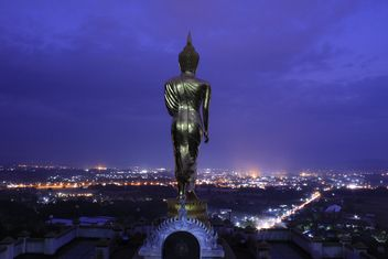 Buddha statue and aerial view on night city, Thailand - бесплатный image #346549