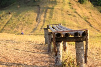 Old wooden bench in field - Free image #346609