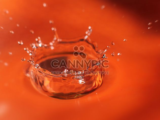 Closeup of water splash on orange background - Free image #347709