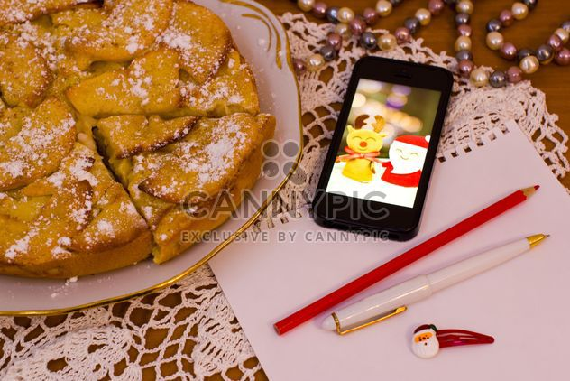 Apple pie, smartphone and paper on table - Free image #347929