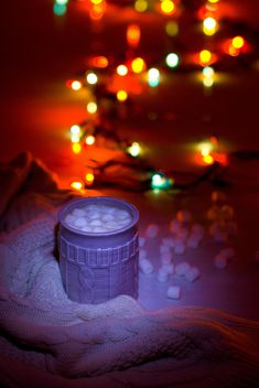 Cup of cocoa with marshmallows in light of garlands - image #347949 gratis