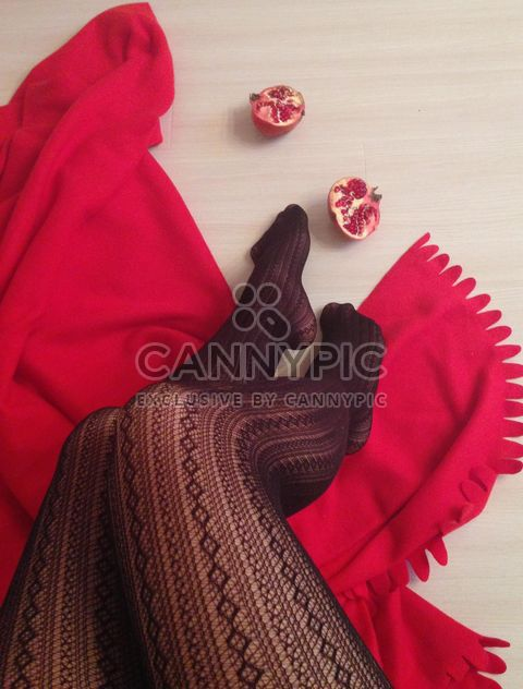 Female legs in black stockings, red blanket and pomegranate - Free image #347999