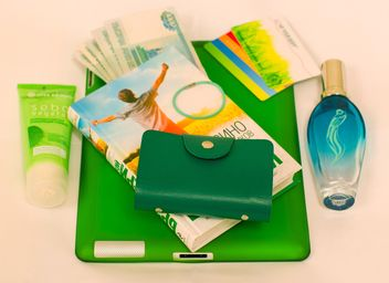 Green things from female handbag - бесплатный image #348009