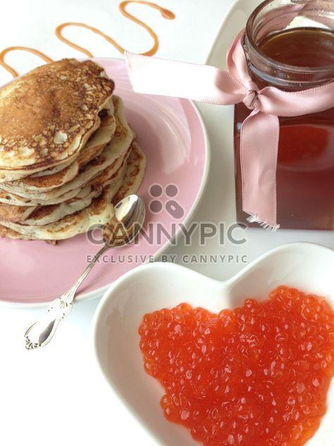 Pile of pancakes, jar of honey and caviar - Free image #348389