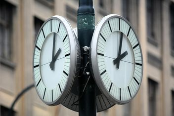Closeup of city clocks on street - image #348489 gratis