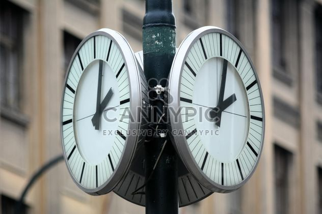 Closeup of city clocks on street - Free image #348489