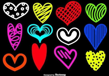 Hand drawn heart silhouettes - Free vector #349659
