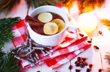 Cup of tea with cinnamon and lemon - image #136239 gratis
