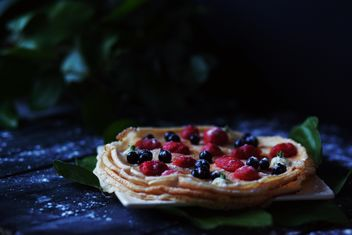 Pancakes with berries on wooden background - image #136459 gratis