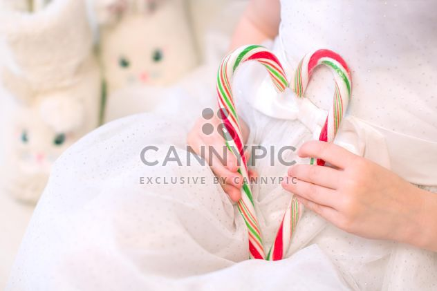 Candies in small girl's hands - Free image #182559