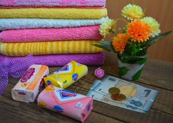 Bath towels and three boxes of good soap - image #182799 gratis