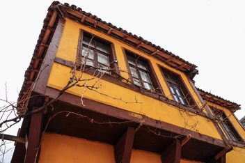 Facade of yellow house - Free image #182979