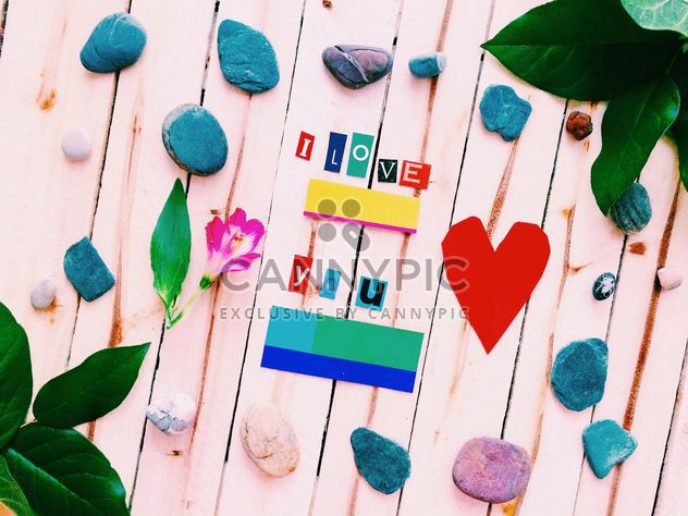 Paper heart, stones and leaves on wooden background - image #184109 gratis