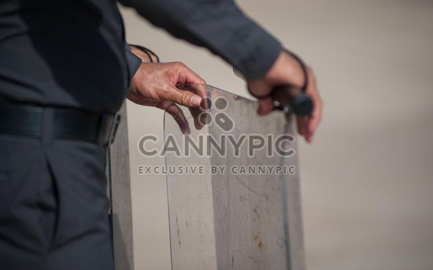 policeman holding a billboard - image gratuit #186319