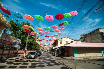 Colorful umbrellas in the air - image #186549 gratis