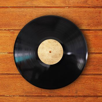 Record vinyl on wooden background - image gratuit #186979