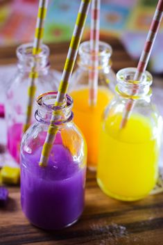 Bottles of colorful drinks - image #187609 gratis