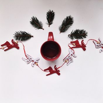 Cup of tea and Christmas decorations on white background - Kostenloses image #198449