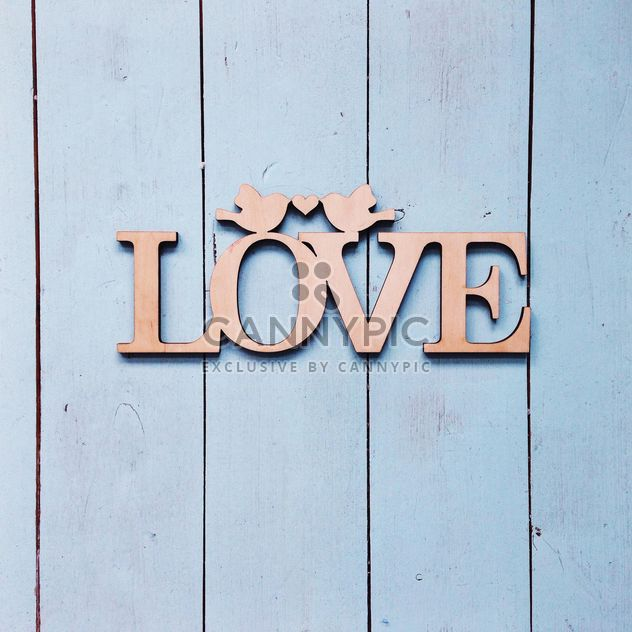 Love sign on wooden background - Free image #198479