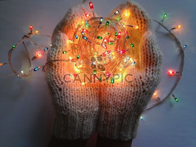 Soft warm knitted mittens hold garland - image gratuit #198779
