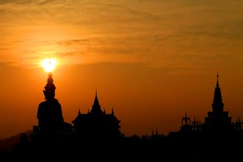 Buddha statue and temples at sunset - Free image #199029