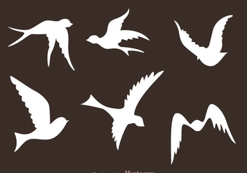 Flying Bird Silhouette Vectors - Free vector #200569