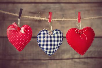 # Hearts attach to rope on wooden background - бесплатный image #271619