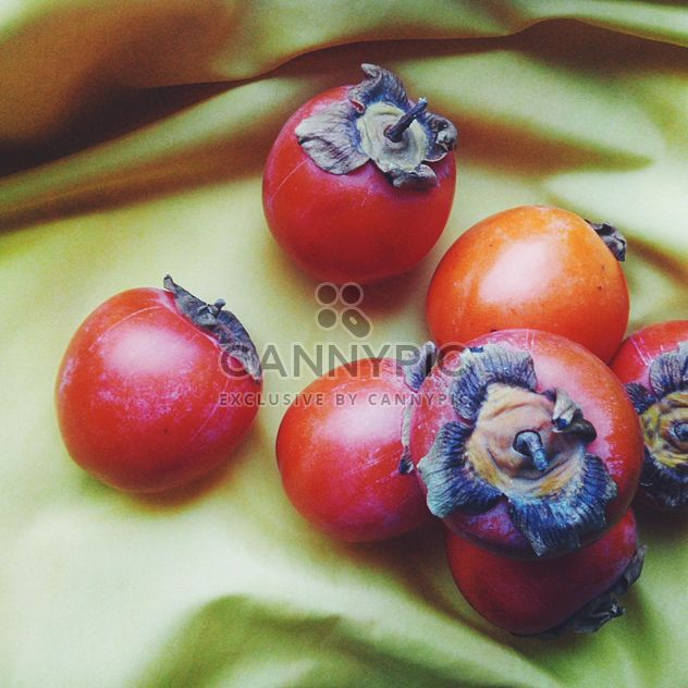 Ripe persimmons on cloth background - Free image #272219