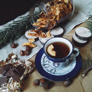 Cup of tea, dried apples and chocolate - image #272249 gratis