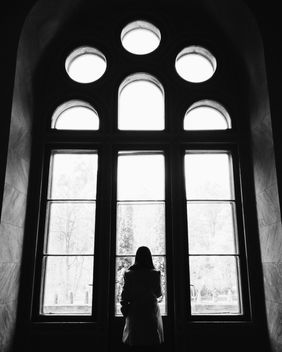 Girl looking through a window - Free image #272299