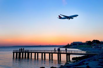 Airplane in sky and landscape on seaside - бесплатный image #272349