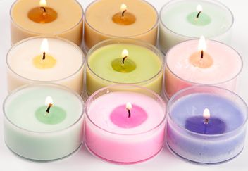 Colored candles on white background - image gratuit #272529