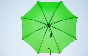 Green umbrella hanging - image #273089 gratis