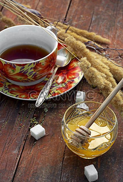 Honey, cup of tea and wheat spikelets - Free image #302079