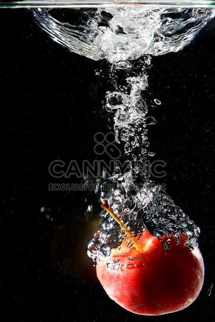 Apple falling into water - Free image #303279