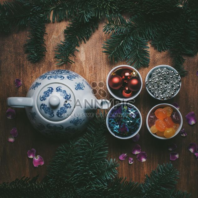 Teapot and Christmas decorations on wooden background - Free image #303949
