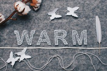 Word warm, cotton branch, featheron felted background - Free image #305759
