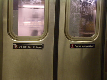 'Do not Fall in Love' sticker on the subway, NYC - image #307609 gratis