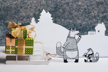 Paper foxes with gifts on sledge in winter - image gratuit #327309