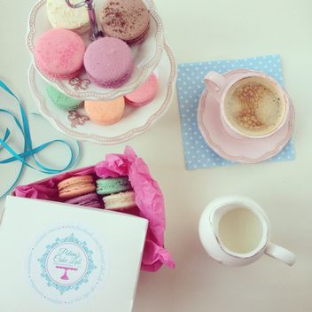 Macaroons, cup of coffee and jug of milk - image #329069 gratis
